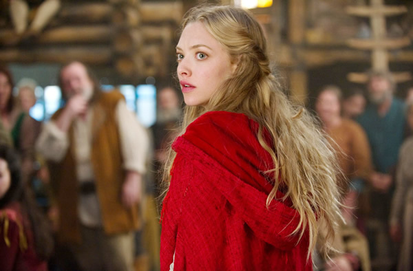Amanda Seyfried dons the iconic red hood in Red Riding Hood.